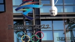 Olympic Chief Promises Safe Games in China, But Beijing's Credibility in Question