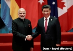 Chinese President Xi Jinping (R) shakes hands with Indian Prime Minister Narendra Modi during the G20 Summit in Hangzhou, Zhejiang province, China on September 4, 2016.
