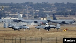 Turkey -- US Air Force A-10 Thunderbolt II fighter jets (foreground) are pictured at Incirlik airbase in the southern city of Adana, December 11, 2015