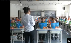 "Screenshot from a CCTV report on ""vocational training facility"" in Xinjiang."