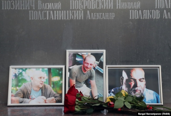 RUSSIA -- Flowers brought to the Central House of Journalists in memory of three Russian journalists killed in the Central African Republic, Moscow, July 31, 2018