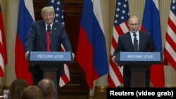 Helsinki, Finland -- Russian President Vladimir Putin and Presidend Donald Trump speak at a joint news conference following their meeting Monday, July 16, 2018.