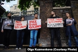 BBC Editor Andrei Kozenko (center) and his wife Julia Lebedeva (second L) on a Picket in support of detained journalist Ivan Golunov outside the Russian Embassy in London, UK on June 8, 2019.
