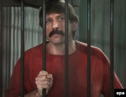 Russian arms trader Viktor Bout stands inside a cell at the criminal court in Bangkok, October 4, 2010.