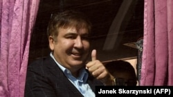 Saakashvili gestures as he sits in a bus leaving from Rzeszow, Poland, towards the Ukrainian border, September 10, 2017.