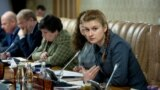 RUSSIA -- Maria Butina (R) attends a meeting of expert group at the Russian Government in Moscow, undated