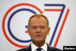European Council President Donald Tusk speaks during a news conference on the margins of the G7 summit.