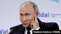 Russia's President Vladimir Putin at an annual meeting of the Valdai Discussion Club.