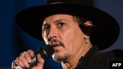U.K. -- Actor Johnny Depp introduces his film, The Libertine, to the audience at 'Cineramageddon', the outdoor cinema venue, at the Glastonbury Festival of Music and Performing Arts on Worthy Farm near the village of Pilton in Somerset, June 22, 2017