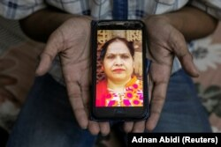 Fardeen Khan, 19, a student, shows a picture on his phone of his mother Noor Jahan, a housewife, who died due to the coronavirus disease (COVID-19), for a photograph, in New Delhi, India, September 27, 2020.