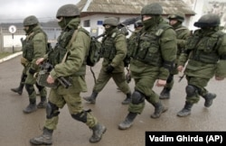 UKRAINE – Russian soldiers march outside an Ukrainian military base in Perevalne, Crimea, March 20, 2014.