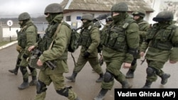 UKRAINE – Russian soldiers march outside an Ukrainian military base in Perevalne, Crimea, March 20, 2014