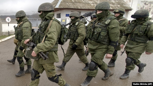 UKRAINE – Russian soldiers march outside a Ukrainian military base in Perevalne, Crimea, March 20, 2014.