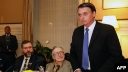 Brazilian President Jair Bolsonaro, Olavo de Carvalho and Brazilian Foreign Minister Ernesto Araujo during a meeting at the Brazil embassy in Washington, D.C., United States, on March 17, 2019.