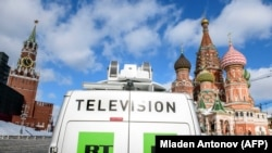RUSSIA -- A Russia's state-controlled Russia Today (RT) television broadcast van is seen parked in front of St. Basil's Cathedral and the Kremlin next to Red Square in Moscow, March 16, 2018