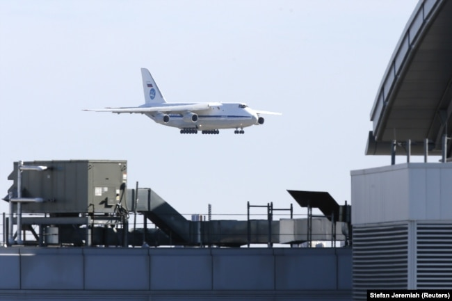 U.S. -- A Russian military transport plane carrying medical equipment, masks and supplies lands at JFK International Airport during the outbreak of the coronavirus disease (COVID-19) in New York City, New York, U.S., April 1, 2020.
