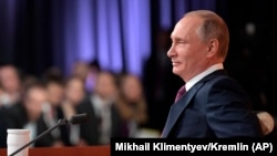 Putin speaks during his annual news conference in Moscow, December 14, 2017.