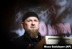 CHECHNYA -- Chechen leader Ramzan Kadyrov speaks in front of a portrait of his father Akhmad Kadyrov, the Chechen president who was assassinated in a 2004 bomb blast, during a meeting in Grozny, May 10, 2019