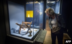 Netherlands -- A visitor looks at artefacts on display during the exhibition 'Crimea: Gold and Secrets of the Black Sea' at the Allard Pierson Museum in Amsterdam, August 21, 2014