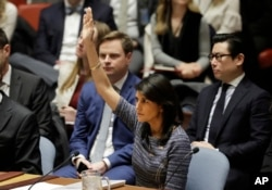 U.S. Ambassador to the UN Nikki Haley votes in favor of a UN resolution proposing new sanctions against North Korea, UN headquarters, New York, December 22, 2017.