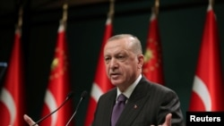 TURKEY – Turkish President Tayyip Erdogan speaks during a news conference, December 14, 2020.
