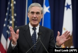 U.S,. -- Former Federal Bureau of Investigation (FBI) Director Robert Mueller speaks during a farewell ceremony in Mueller's honor at the Department of Justice, August 1, 2013