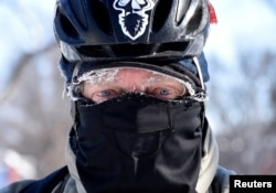 Don Wolford rides his bike to work in frigid temperatures in Fargo, North Dakota, U.S., January 31, 2019. REUTERS/Dan Koeck