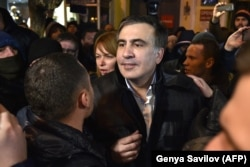 Saakashvili speaks to journalists and supporters outside the courthouse in Kyiv, December 11, 2017.