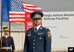 A Romanian officer awaits the ceremony marking the construction of a U.S. Aegis Ashore missile defense base in Deveselu, Romania, October 28, 2013.