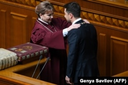 UKRAINE -- Volodymyr Zelenskiy receives presidential symbols from Natalia Shaptala, Chairman of the Constitutional Court of Ukraine, during his inauguration ceremony at the parliament in Kyiv, May 20, 2019