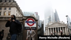 People exit Bank station in the City of London financial district, amid the coronavirus disease (COVID-19) outbreak, in London, Britain, March 4, 2021.