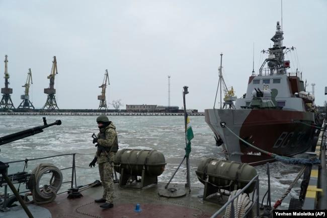 UKRAINE -- A Ukrainian serviceman stands on board a coast guard ship in the Sea of Azov port of Mariupol, eastern Ukraine, December 3, 2018