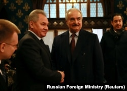 RUSSIA -- Commander of the Libyan National Army (LNA) Khalifa Haftar shakes hands with Russian Defense Minister Sergei Shoigu before talks in Moscow, January 13, 2020.