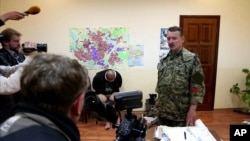 UKRAINE – This image taken from Associated Press video shows Igor Girkin (Strelkov), military commander of pro-Russian militias in Slovyansk talking to journalists in Slovyansk, April 27, 2014