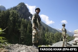 Indian paramilitary soldiers stand guard at a check post along a highway leading to Ladakh, at Gagangeer some 81 kilometers from Srinagar, India, the summer capital of Indian Kashmir.