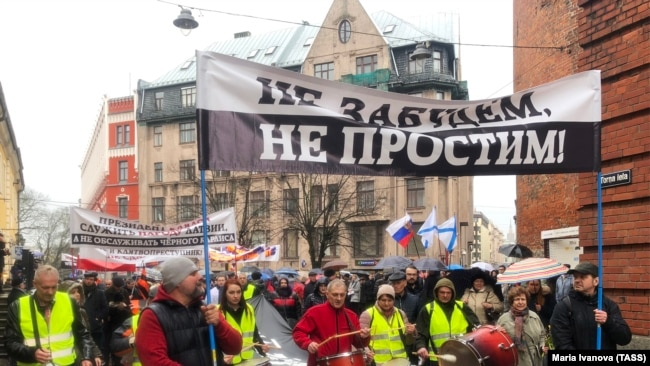 LATVIA -- People protest against a language reform excluding Russian language learning from schools, in the capital of Riga, April 4, 2018.
