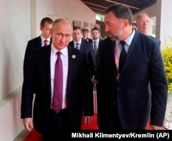 Russia's President Vladimir Putin and Russian metals magnate Oleg Deripaska walking to attend the APEC Business Advisory Council dialogue in Danang, Vietnam, November 10, 2017. Deripaska is among many other individuals targeted by the April 6 sanctions.