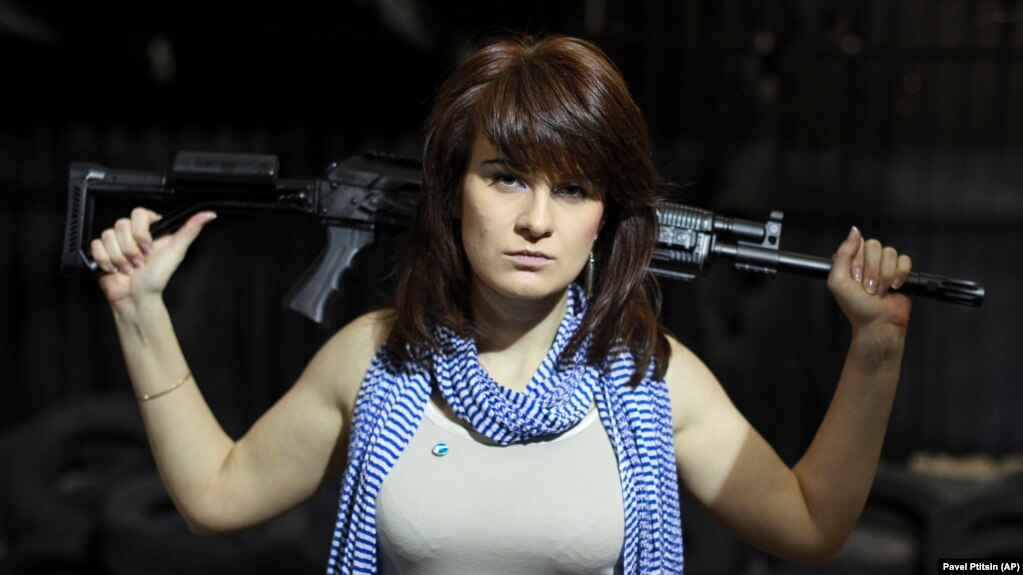 RUSSIA -- Maria Butina, a gun-rights activist, poses for a photo at a shooting range in Moscow, April 22, 2012.