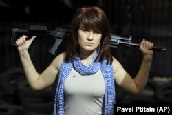 RUSSIA -- Maria Butina, a gun-rights activist, poses for a photo at a shooting range in Moscow, April 22, 2012
