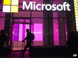 People walk past a Microsoft office in New York on November 10, 2016.