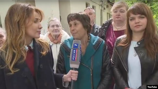 A screen grab of RT's YouTube channel showing the women of Strunino in Russia, asking about their town's crumbling hospital building.