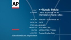 Russia's parliament adopts a law allowing for designation of news outlets as foreign agents