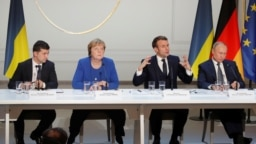 FRANCE - Ukraine's President Volodymyr Zelensky, German Chancellor Angela Merkel, French President Emmanuel Macron and Russia's President Vladimir Putin attend a joint news conference after a Normandy-format summit in Paris, France, December 9, 2019