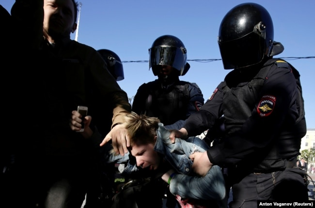 RUSSIA -- Police officers detain a participant during a rally held by LGBT activists and their supporters on the International Day Against Homophobia, Transphobia and Biphobia in central Saint Petersburg, Russia May 17, 2019.