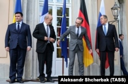 GERMANY -- (L-R) Ukrainian Foreign Minister Pavlo Klimkin, French Foreign Minister Jean-Yves Le Drian, German Foreihgn Minister Heiko Maas and Russian Foreign Minister Sergei Lavrov pose for a picture in Berlin, June 11, 2018