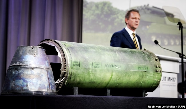 NETHERLANDS -- Head prosecutor Fred Westerbeke speaks next to a part of the BUK rocket that was fired on the Malaysia Airlines flight MH17 during the press conference of the Joint Investigation Team, in Bunnik, May 24, 2018