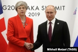 JAPAN -- British Prime Minister Theresa May and Russian President Vladimir Putin meet on the sidelines of the G20 summit in Osaka, June 28, 2019