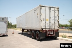 A refrigerated trailer acquired to store bodies, as morgues at hospitals and funeral homes reach their capacity with COVID-19 fatalities, is seen in Bexar County, Texas, July 15, 2020.