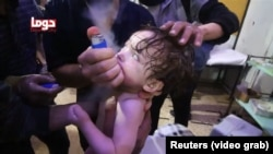 Video posted to a social media Web site shows a child being treated with an inhaler following the attack in Douma, Syria, April 7. 2018. Sources: Reuters (video grab)