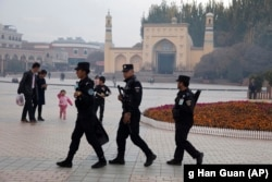 CHINA -- Uighur security personnel patrol near the Id Kah Mosque in Kashgar in western China's Xinjiang region, November 4, 2017